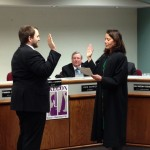 Commissioner Ken Johnson is sworn in by 60th Circuit Court Judge Maria Ladas Hoopes on January 2, 2014.